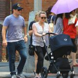 Hilary Duff pushes her baby boy Luca Cruz in his covered stroller while out walking in New York City with her husband Mike Comrie and a female friend