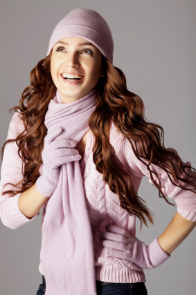 Happy beautiful woman in winter clothes